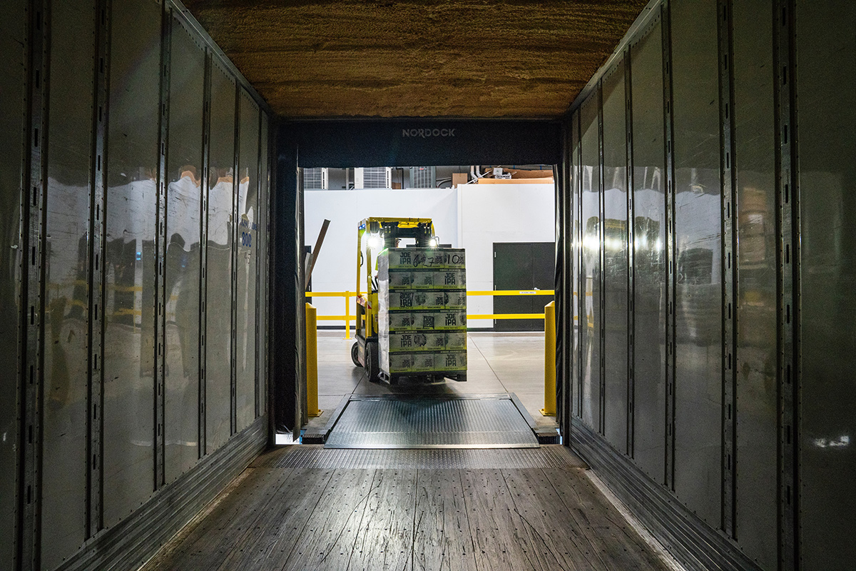 Forklift loading products into a truck